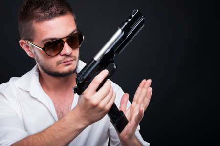 deadly: Armed gangster man with weapon as outlaw and murderer concept