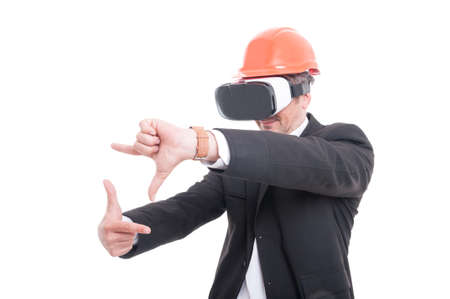 hard: Foreman gesturing picture wearing virtual reality goggles and hardhat isolated on white background