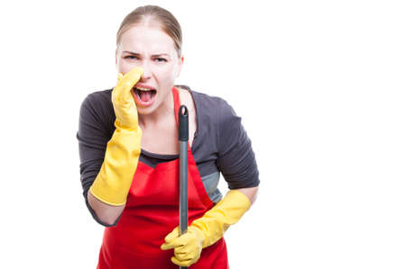 Caucasian cleaning lady in uniform and gloves shouting out loud isolated on white background with text space
