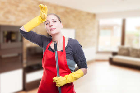 Cleaning woman being tired and exhausted after cleaning the house with advertising area