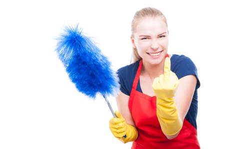 rudeness: Housewife in cleaning clothes rising middle finger looking arrogant and rude