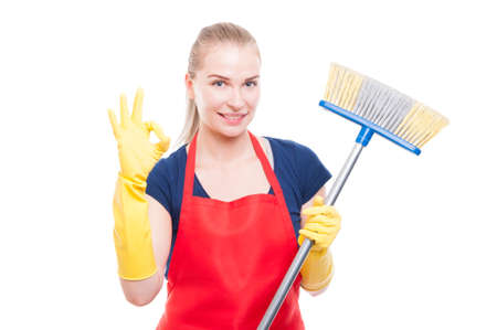 Great cleaning services concept with beautiful housekeeping lady showing ok sign gesture