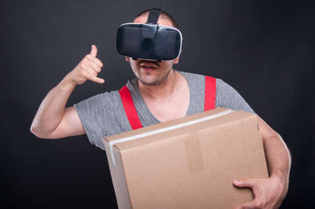 Mover guy wearing vr glasses making calling gesture on black background