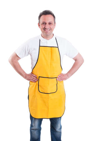 Young man with yellow apron posing confident and smiling cheerfully