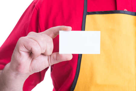 Hypermarket employee holding empty business card in close-up with copy text space Stock Photo