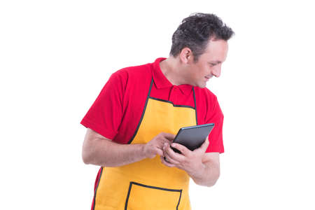 Male seller using a digital tablet to count the product in the store isolated on white background Stock Photo