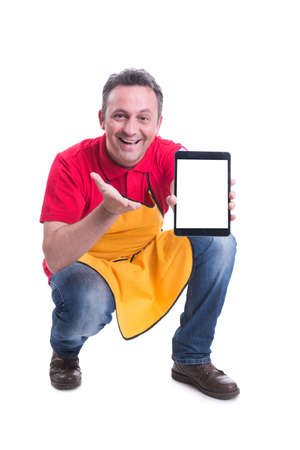 Cheerful salesman showing his modern blank screen tablet with copy space