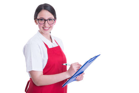 Friendly supermarket employee writing the missing products on her clipboard Stock Photo