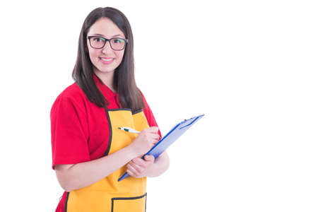 Beautiful successful storekeeper taking notes on her clipboard isolated on white with copyspace