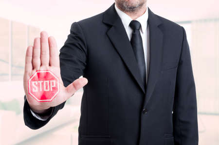 Business man showing stop sign gesture with his palm in close up view