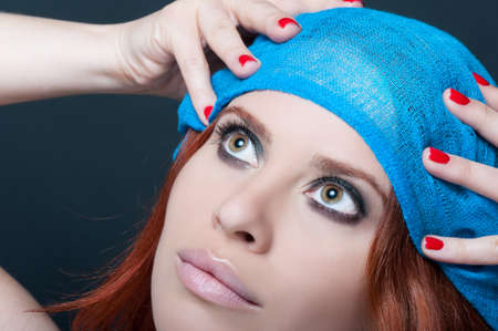gorgeus: Young woman face with gorgeus makeup and trendy nails in closeup. Fachion and beauty concept