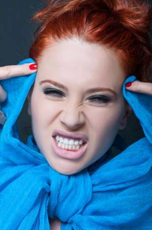 Woman model with crazy expression showing her teeth with anger Stock Photo