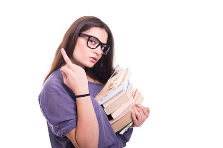Arrogant girl student carrying books and showing her middle finger acting rude Stock Photo