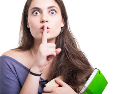 Beautiful young student doing silence or shush gesture on white background with copy text space Stock Photo