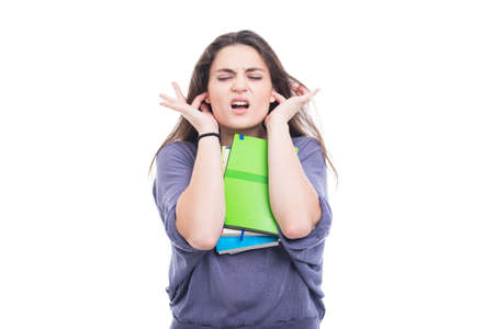 Young college student covering her ears. Hear no evil concept Stock Photo