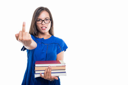 Portrait of student girl holding books showing middle finger obscene gesture isolated on white background with copypsace advertising area