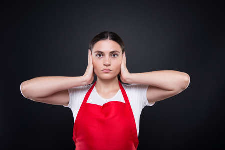 Supermarket selle dont want to hear anything and doing hear no evil gesture