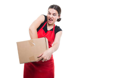 Crazy female seller breaking a storage box at her job isolated on white background