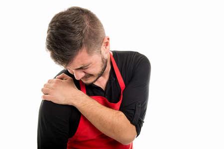 Male supermarket employer holding shoulder like hurting isolated on white background Stock Photo