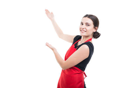 Woman employee showing some product or sign text on white background