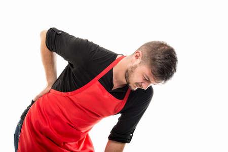 Supermarket employer bending holding back like hurting isolated on white background