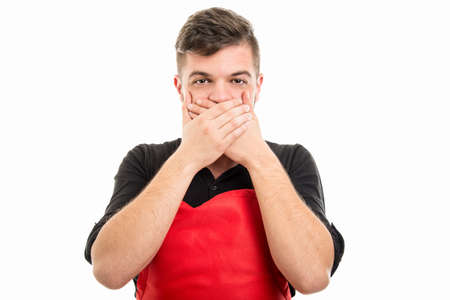 Male supermarket employer covering mouth like not speaking or monkey concept isolated on white background