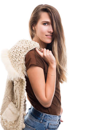 Beautiful trendy woman holding knitted jacket as glamourous and cozy outfit concept