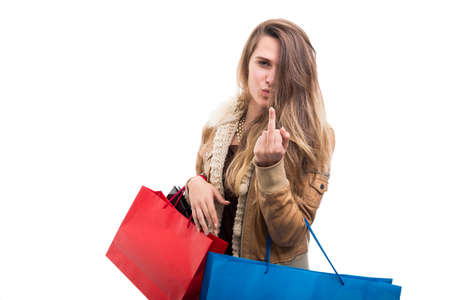Rude hipster fashion girl doing obscene gesture while doing shopping