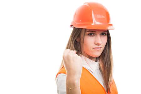 Young girl engineer holding her left fist up being ready to punch someone on white background with copyspace Stock Photo