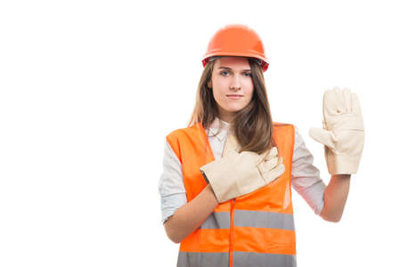 Beautiful female engineer making true oath with hand on heart as real vow concept