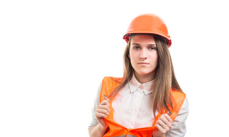 Portrait of female constructor opening her protection vest isolated on white with advertising area Stock Photo