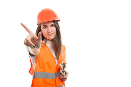 Female builder shows one finger on white background as denial or refusal gesture concept with advertising area