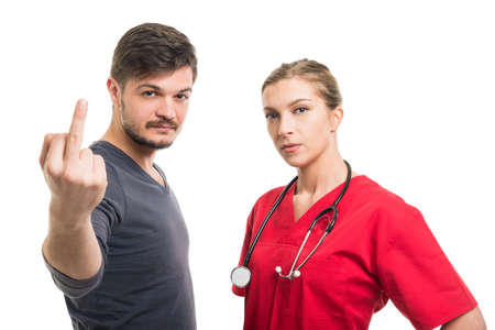 Lady doctor and male patient showing middle finger isolated on white background