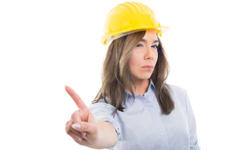 Portrait of female constructor showing denial gesture on white background with copypsace advertising area Stock Photo