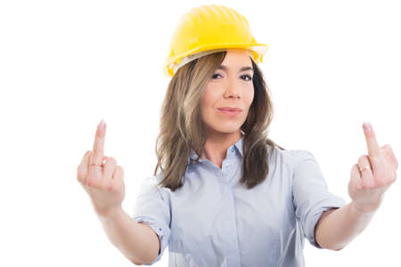Portrait of female constructor showing double obscene gesture isolated on white background with copypsace advertising area Standard-Bild