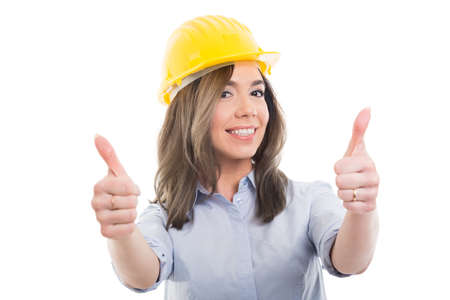 Portrait of female constructor showing double  like gesture on white background with copypsace advertising area