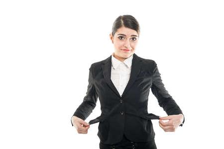 Beautiful female flight attendant having empty pockets looking sad isolated on white background