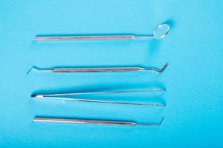 Dentistry set of four tools on blue background