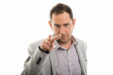Portrait of business man making Im watching you gesture isolated on white background with copyspace advertising area