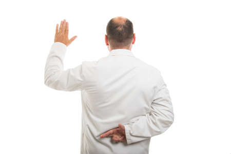 Back view of male doctor showing fake oath gesture isolated on white background with copyspace advertising area