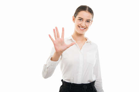 Portrait of young pretty bussines woman showing number five with fingers isolated on white background with copyspace advertising area