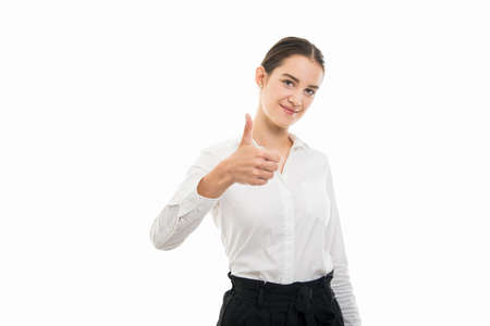 Portrait of young pretty bussines woman showing thumb up gesture isolated on white background with copyspace advertising area