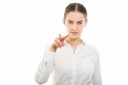 Portrait of young pretty business woman showing Im watching you gesture isolated on white background with copy space advertising area