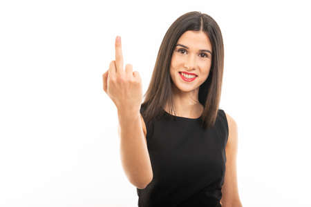 Portrait of beautiful young lawyer posing showing middle finger isolated on white background with copy space advertising area Banco de Imagens - 124872272