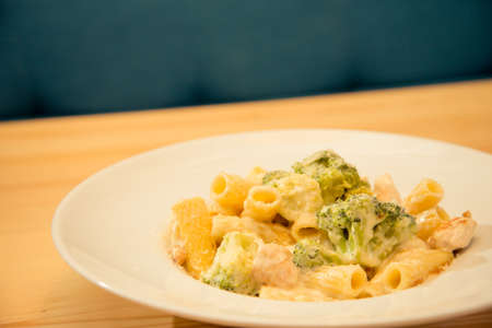 Tasty plate of broccoli and chicken pasta on bistro or restaurant plate