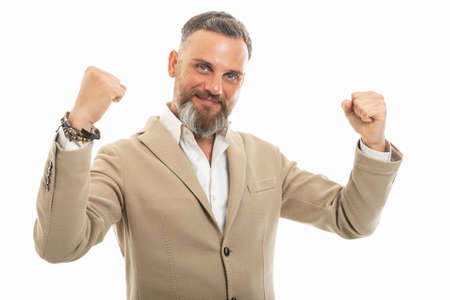Portrait of handsome man wearing smart casual making happy gesture like a winner isolated on white background
