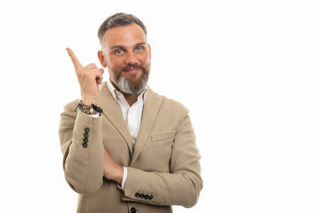 Portrait of man wearing smart casual clothes making good idea gesture isolated on white background with copy space advertising area
