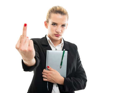 Young female assistant manager holding agenda showing middle finger isolated on white background with copy space advertising area
