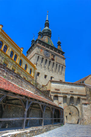 Sighisoara citadel, with the old clock tower in the back. HDR image. photo