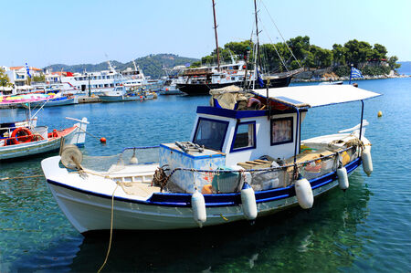 skiathos: Traditional Greek fishing boat moored in the Skiathos marina, Greece. HDR image. Stock Photo
